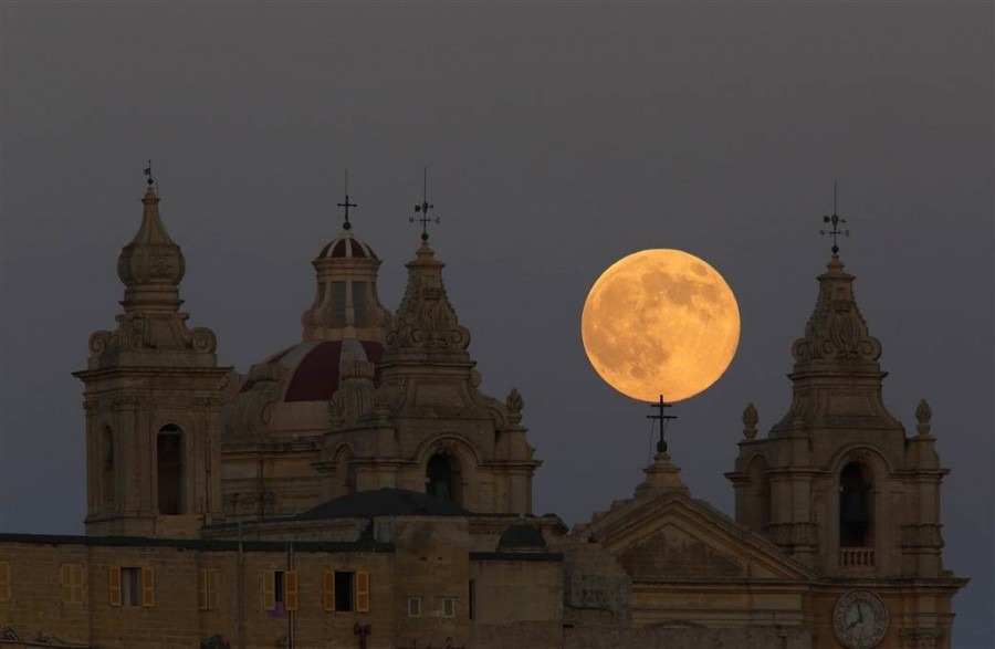 8 A supermoon rises behind the cathedral in Mdina, Malta's ancient capital city, in the center of the island, on August 10.