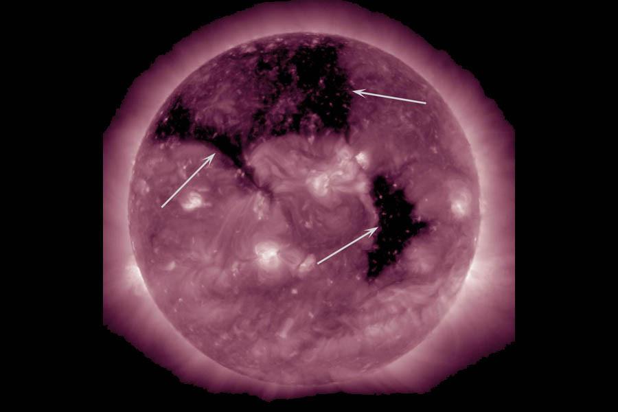coronal_holes_aia211_arrows.jpg