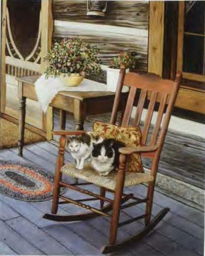Кошки на стуле