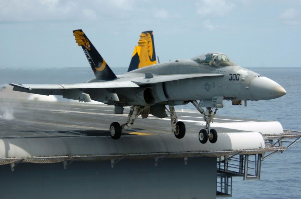 An_F-A-18C_Hornet_launches_from_the_flight_deck_of_the_conventionally_powered_aircraft_carrier