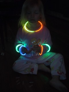 [photo of Jesara with glow sticks]