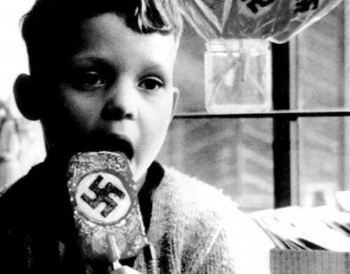 A child eating a Nazi ice lolly (c. 1940) - Imgur