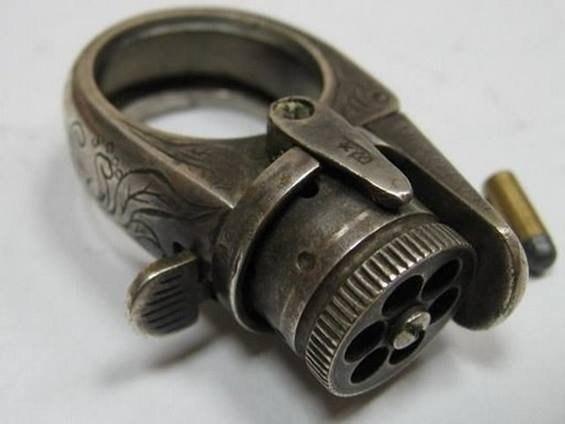 кольцо пистолет
