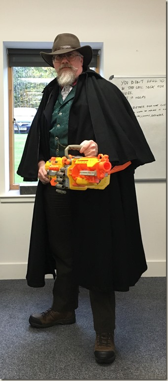 Me as a cowboy with a belt-fed Nerf machine gun