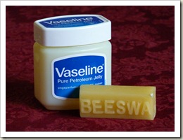 Moustache wax ingredients - a jar of Vaseline and a stick of beeswax