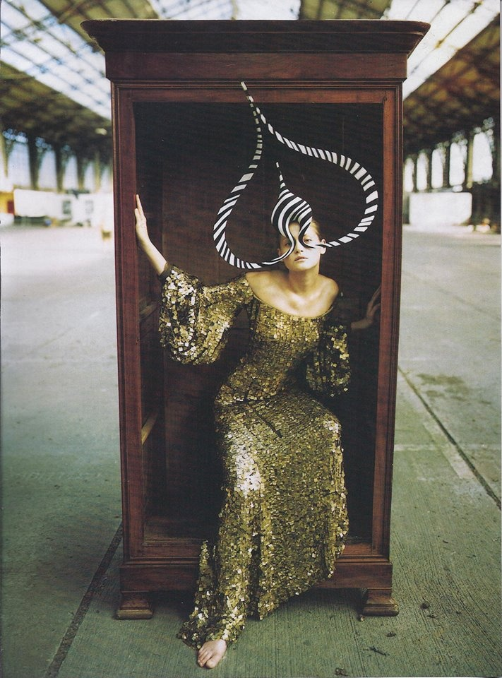 Hat by Philip Treacy, Dress by Alexander McQueen for Givenchy.