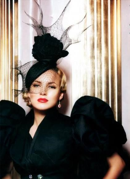 Martha Sitwell wearing a Philip Treacy hat.