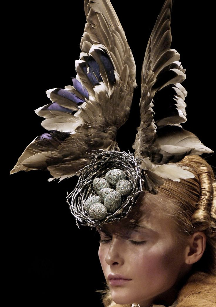 Snejana Onopka at Alexander McQueen AutumnWinter 2006, wearing a Philip Tracey taxidermy head piece