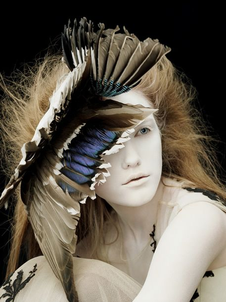 Vlada Roslyakova wears feathered headdress by Philip Treacy for Alexander McQueen FW 2006 photographed by Ben Hassett for Vogue Nippon Beauty September 2006