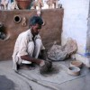 Rural Indian potter prepares clay