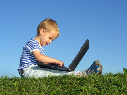 child_with_computer-520x390