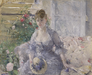 1879 ca. Young Woman Seated on a Sofa by Morisot