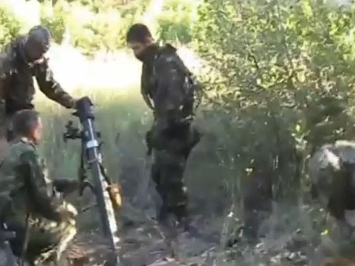 newsukrtime.com_luganskie-opolchency-obstrelivayut-iz-minometa-pozicii-nacgvardii-ukrainy_1