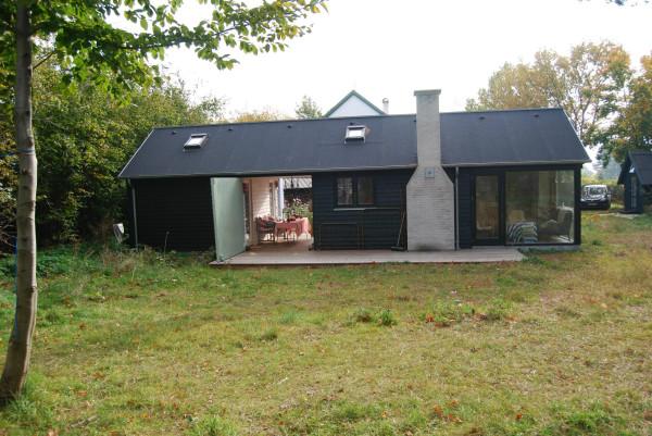 http://smallhousebliss.com/2012/07/19/moen-huset-laengehuset/  -  http://smallhousebliss.com/2012/07/19/moen-huset-laengehuset/moen-huset-laengehus-55-2-exterior3-via-smallhousebliss/  -  https://smallhousebliss.files.wordpress.com/2012/07/moen-huset-laengehus-55-2-exterior3-via-smallhousebliss.jpg?w=600  -  Small House Bliss  - Manufactured by Mon Huset  -  http://www.moenhuset.dk/
