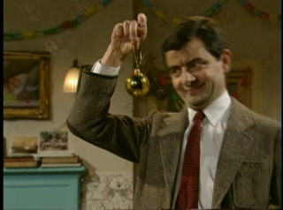 mr bean goes home and does all the normal christmas eve things we see that hes cut just the top 3 feet off the massive tree hes stolen and throws the - Merry Christmas Mr Bean