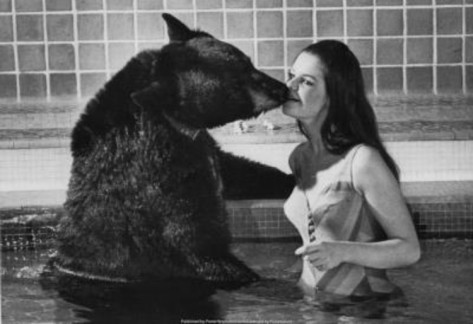 bear-kissing-woman-archival-photo-poster