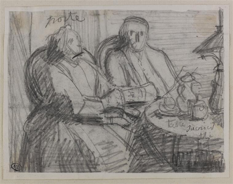 Une femme et un homme assis dans des fauteuils devant une table