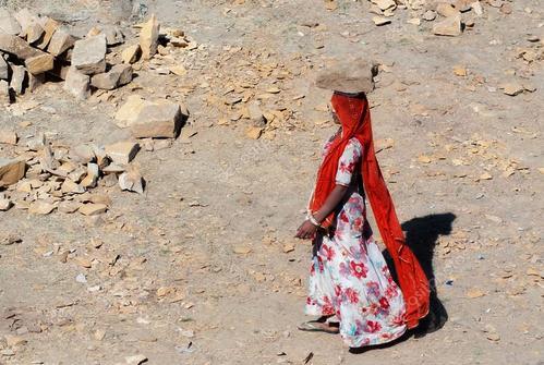 depositphotos_51471231-stock-photo-woman-carries-a-brick-on