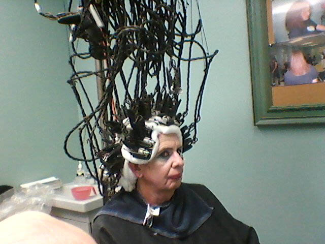 photos of a man all wired up to an antique perm machine