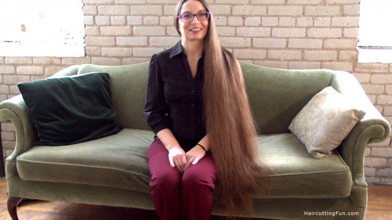 Deb sitting on the couch, after a good hair brushing. Her hair touching the bottom of the couch front.