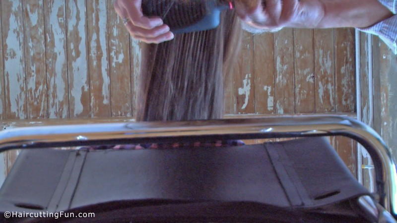 Debbie's hair being brushed