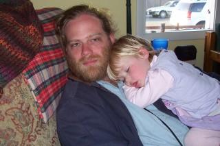 Kjersti napping on Daddy