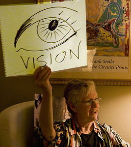 honoria holding drawing of an eyeball with the word vision under it