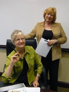 Honoria and Marie at Gracy Title for Closing signature session. April 2010