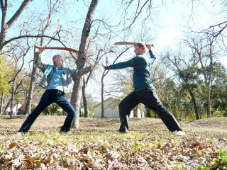 Honoria and Tai chi buddy in the park doing free form broadsword exercise  December 2010