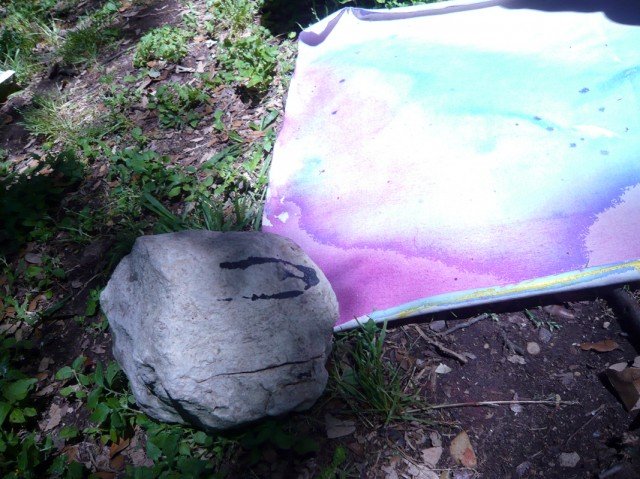 Use rocks to hold down paintings in the wind