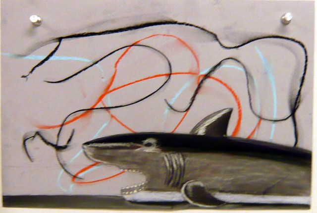 Student's observed still life drawing of a toy shark on top of deliberately marked paper.