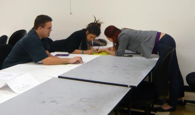 Students working on Mardi Gras Design in Design Fundamentals.  Honoria Starbuck Instructor.