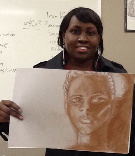 Chessie, Observational Drawing student shows off her drawing from the portraits chapter of Drawing on the Right Side of the Brain
