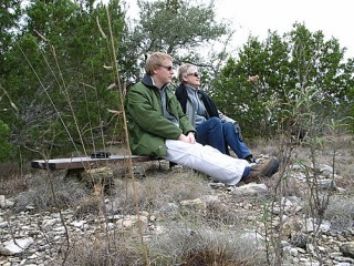 honoria and knut on a rock and plank bench