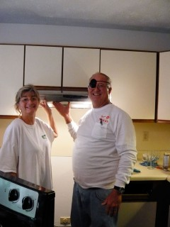 photo of hoppy and nancy with a freshly installed stainless range hood