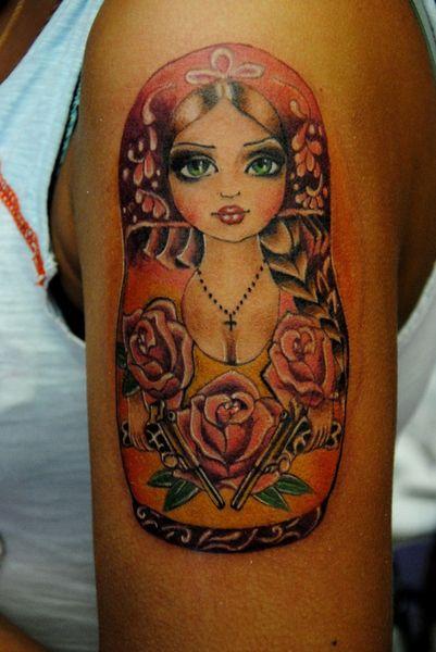 Что означает татуировка матрешки