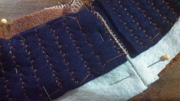 Close up of the non-overlapped seams and the fake pads stitching