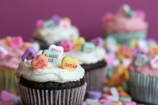 Delicious looking chocolate cupcakes with candy hearts and white frosting!