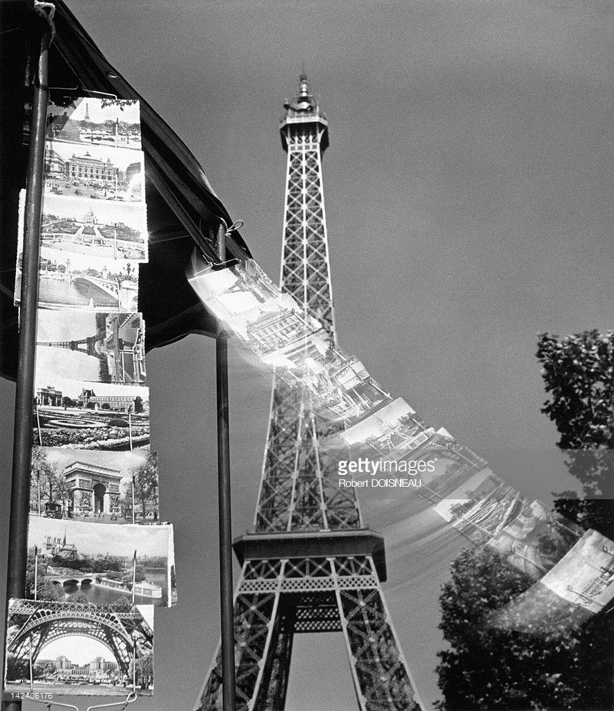1953. Открытки с видами Парижа, летящие по ветру перед Эйфелевой башней
