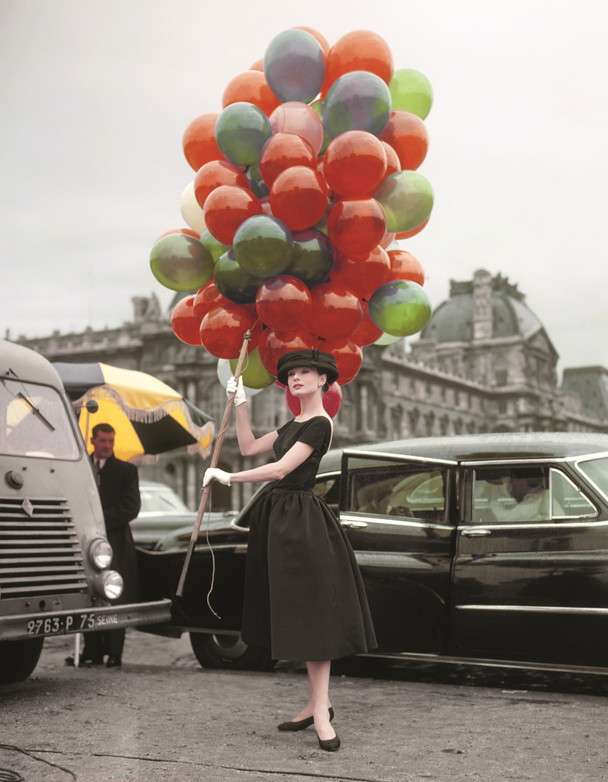 audrey-hepburn-posing-on-location-at-the-jardin-des-tuileries-in-paris-while-filming-22funny-face-22-hepburn-is-wearing-a-dress-by-givenchy-nmn.jpg