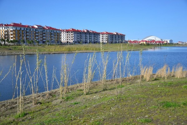 the-olympic-village-with-fisht-stadium-in-the-background