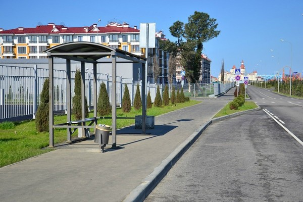 a-bus-stop-with-the-still-being-built-amusement-park-in-the-background