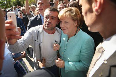 why-angela-merkel-is-taking-selfies-with-refugees_1