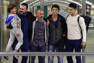 osama-abdul-mohsen-poses-sons-atocha-train-station-madrid-september-17-2015-afp
