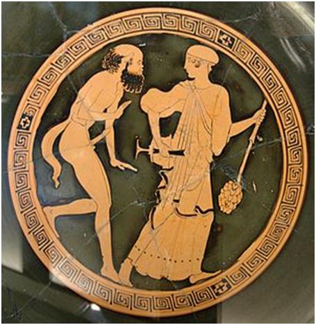 Сатир и менада, держащая в руке тирс, краснофигурный килик, Лувр