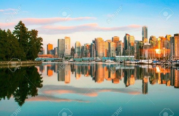 19140722-Beautiful-view-of-Vancouver-skyline-with-Stanley-Park-at-sunset-British-Columbia-Canada-Stock-Photo.jpg