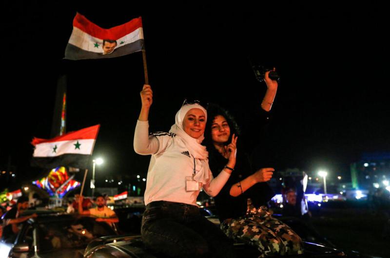 Сирийцы радуются победе Башара Асада
