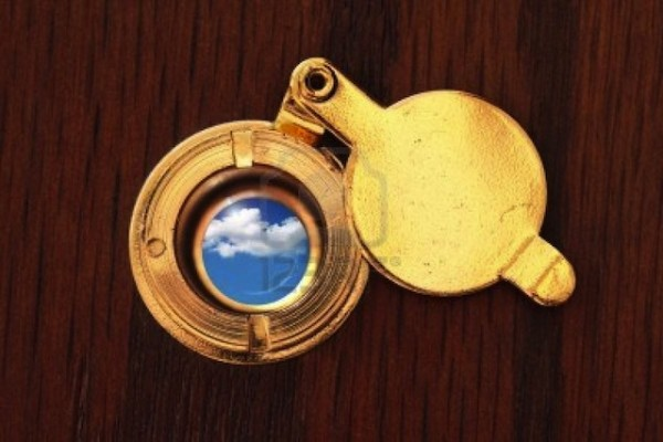 4916409-peephole-to-the-better-world-close-up-of-door-viewer-and-cloudy-sky