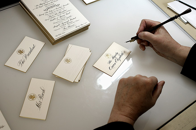 (c) 2007 Brooks Kraft / Corbis for TIME - Handwritten; A White House calligrapher works on place cards and menus for a State Dinner in honor of the Queen Elizabeth II, to be held May 7, 2007. The White House employs three full-time calligraphers, who create awards, citations, invitations and numerous other personalized items.
