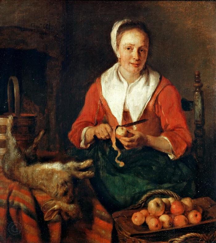 Женщина, чистящая яблоки